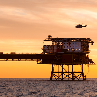 Offshore oil rig with sunset and helicopter telehealth solution
