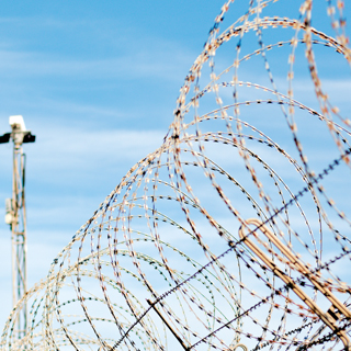 Prison corrective service barbed wire fencing