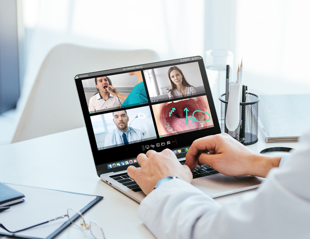 Photo of doctor on laptop with Vision TeleStrations on the screen