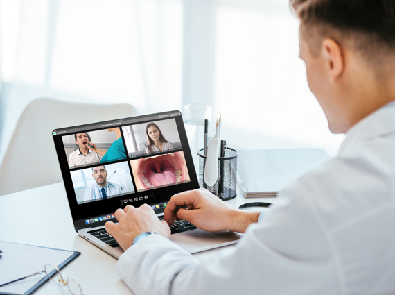 Photo of doctor on laptop in a Vision meeting using MultiVu