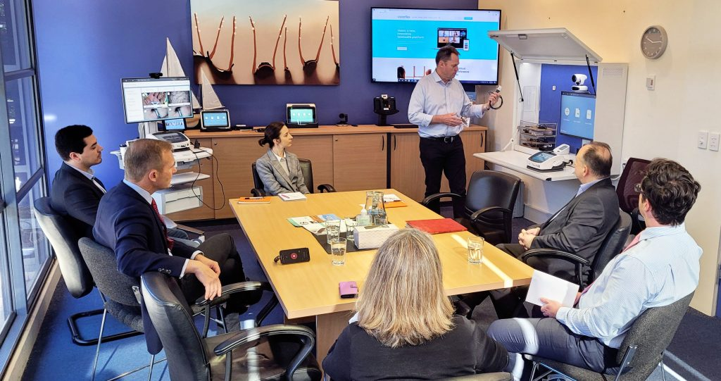 Photo of The Honourable Robert Stokes MP during demonstration of the Visionflex telehealth systems in boardroom