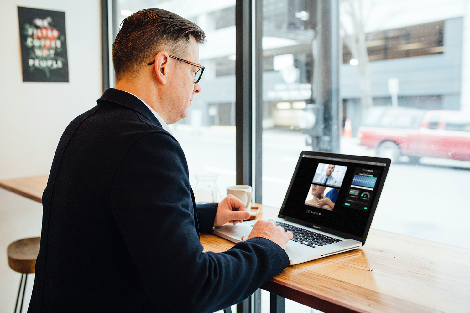 Photo of man on a laptop participating in a telehealth video conference call with TrueSteth